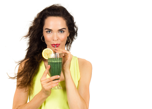 Healthy woman drinking rejuvenate lemonade