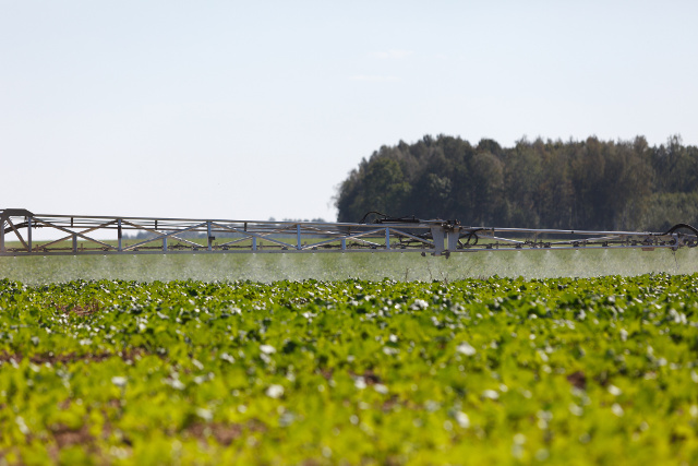 spray pesticides farm equipment conventional gmo